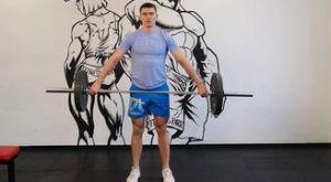 Шраги широким хватом: работающие мышцы и техника выполнения