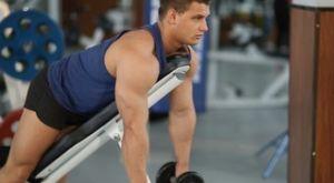 Шраги на наклонной скамье с гантелями: работающие мышцы и техника выполнения