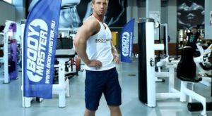 Растяжка мышц средней части спины стоя (с разворотом корпуса): работающие мышцы и техника выполнения